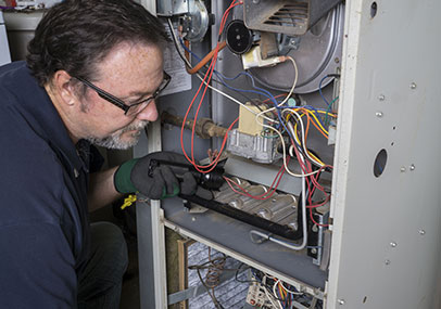 Heating and Cooling Company Dearborn MI - Reckingers - man-inspecting-furnace